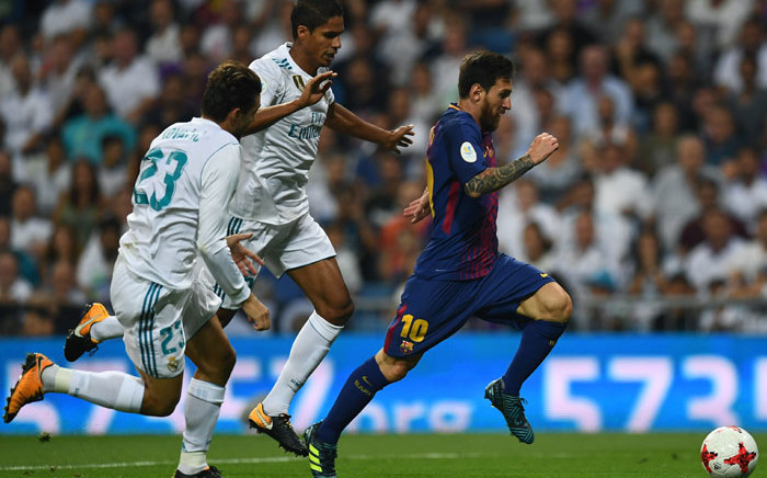 Barcelona forward Lionel Messi (R) speeds away from Real Madrid defender Raphael Varane (C) during the second leg of the Spanish Supercup at the Santiago Bernabeu stadium in Madrid, on August 16, 2017. Picture: AFP