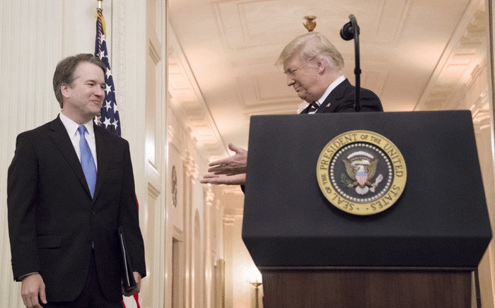 US President Donald Trump (R) gestures to Associate Justice of the US Supreme Court Brett Kavanaugh (L) during a ceremonial swear-in at the White House in Washington, DC, on 8 October 2018. Picture: AFP.