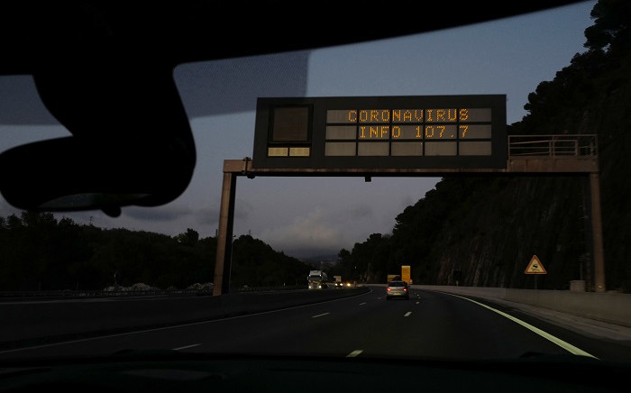 """This picture taken on 9 March 2020, on the A8 motorway towards Italy in Nice southeastern France, shows a board sign reading """"Coronavirus information on 107.7"""". Picture: AFP"""