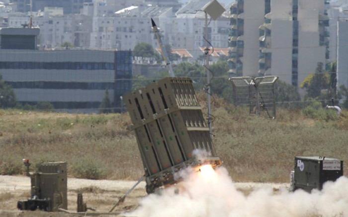 """A missile is launched by an """"Iron Dome"""" battery, a short-range missile defence system designed to intercept and destroy incoming short-range rockets and artillery shells, on 11 July, 2014 in the southern Israeli city of Ashdod. Picture: AFP."""