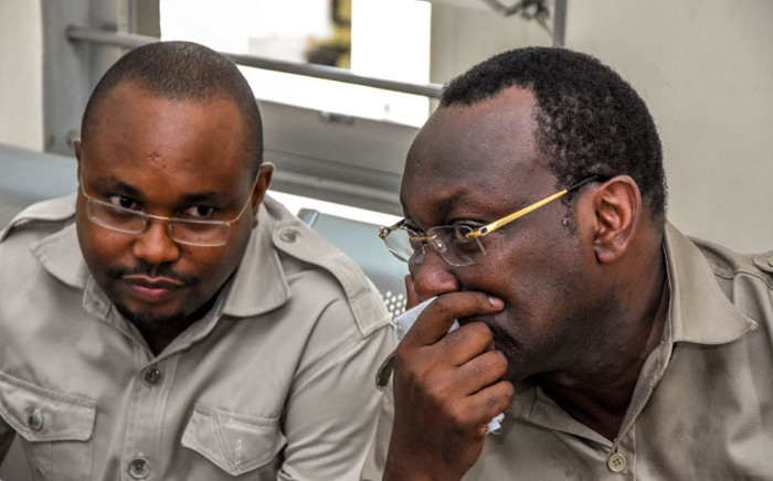 FILE: Chadema party chairperson Freeman Mbowe (R) and general secretary John Mnyika sit in the dock at Kisutu resident magistrates court in Dar es Salaam on 10 March 2020. Picture: AFP