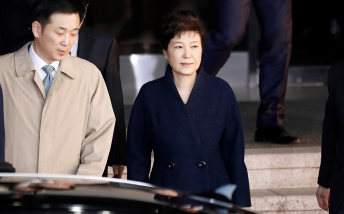 FILE: South Korea's ousted leader Park Geun-hye leaves a prosecutor's office in Seoul on 21 March 2017. Picture: AFP.