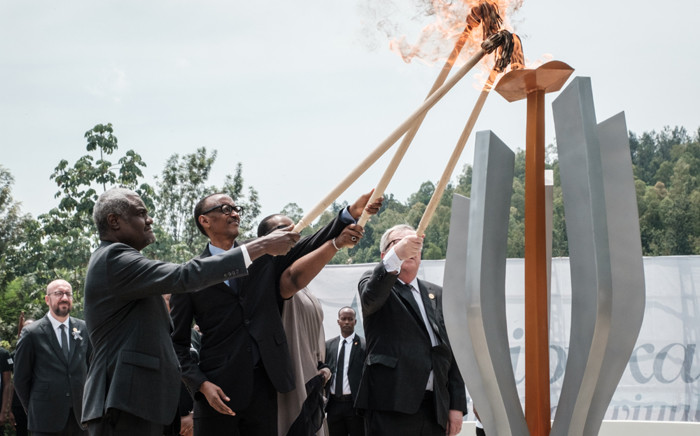 (From L) African Union chief Moussa Faki, Rwanda's President Paul Kagame, his wife Jeannette (2ndR), and European Commission President Jean-Claude Juncker light a remembrance flame for the 25th Commemoration of the 1994 Genocide at the Kigali Genocide Memorial in Kigali, Rwanda, on 7 April 2019. Rwanda on 7 April 2019 began 100 days of mourning for more than 800,000 people slaughtered in a genocide that shocked the world, a quarter of a century on from the day it began. Picture: AFP