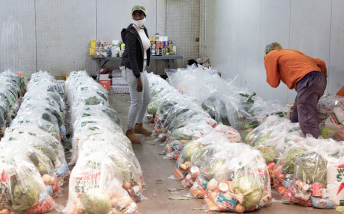 Food parcels are packaged at a food storage facility in Springs, Ekurhuleni, east of Johannesburg on 21 May 2020. Picture: Sethembiso Zulu/EWN