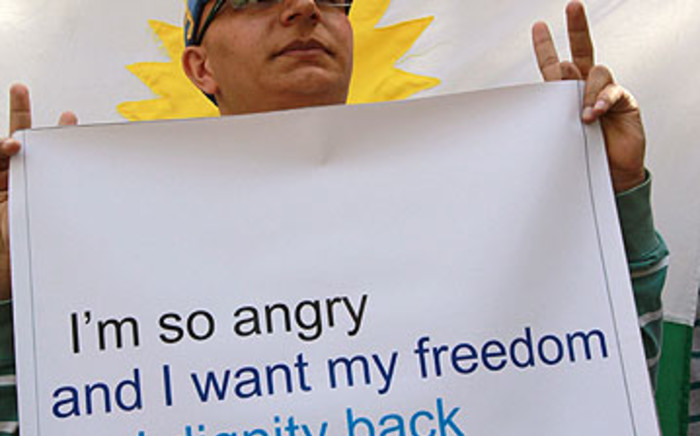 A Syrian Kurdish demonstrator holds a sign during a protest against the Syrian government's crackdown on anti-regime protests across Syria on 23 October 2011. AFP