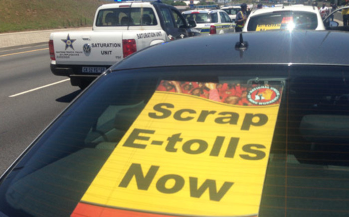 Police patrol as motorists march during the E-toll go slow. Picture: Sebabatso Mosamo/EWN