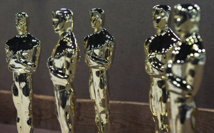 Oscar statuettes sit on a work bench prior to being assembled at R.S. Owens & Company during a media demonstration 9 February 2012 in Chicago, Illinois. Picture: AFP.