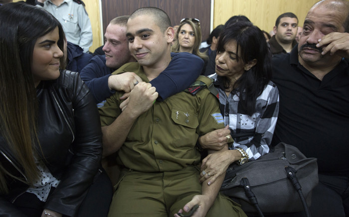 Israeli soldier Elor Azaria (centre), who shot dead a wounded Palestinian assailant, sits with his parents and girlfriend Orel as he awaits the verdict in his case at the military court in Tel Aviv on 4 January 2017. Picture: AFP.
