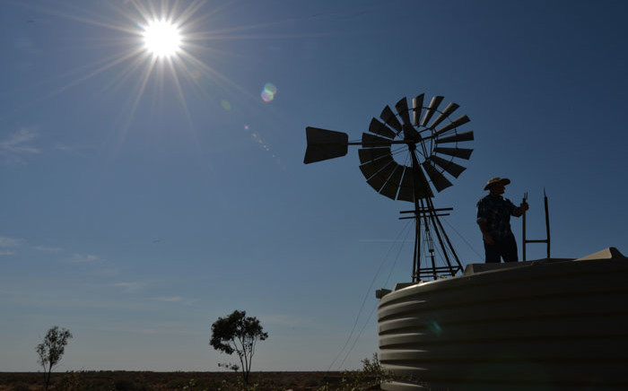 FILE: This picture taken on 28 September 2018 shows farmer Matt Ireson checking a water tank on his property during a severe and prolonged drought outside the town of Booligal in western New South Wales. Picture: AFP
