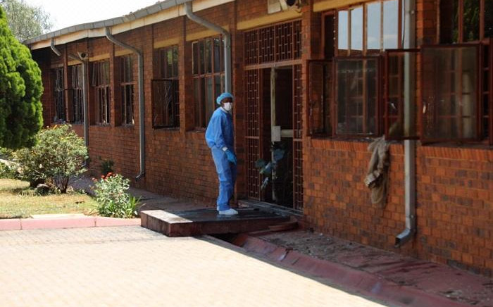 Forensic investigators comb the scene at the Khutlo-Tharo Secondary School in Sebokeng where a fire broke out in the early hours of 15 January 2020. Picture: Ahmed Kajee/EWN