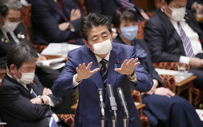Japan's Prime Minister Shinzo Abe, wearing a face mask amid concerns over the spread of COVID-19 coronavirus, attends an upper house committee meeting at the parliament in Tokyo on 1 April 2020. Picture: AFP