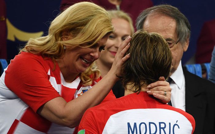 Croatian president Kolinda Grabar-Kitarović consoles Luca Modric following the team's 2018 Fifa World Cup final defeat to France on 15 July 2018. Picture: AFP