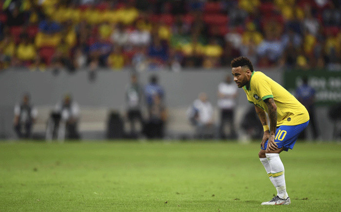 FILE: Brazil's Neymar looks on during a friendly football match against Qatar at the Mane Garrincha stadium in Brasilia on 5 June, 2019, ahead of Brazil 2019 Copa America. Picture: AFP.