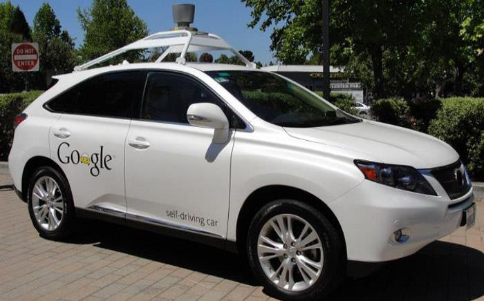 A Google self-driving car is seen in Mountain View, California, on 13 May, 2014. A white Lexus cruised along a road near the Google campus, braking for pedestrians and scooting over in its lane to give bicyclists ample space. Picture: AFP.