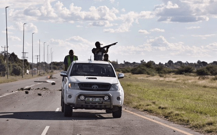 Police use tear gas and rubber bullets to disperse protesters blocking the main road leading into Mahikeng as they continue to call for the removal of Premier Supra Mahumapelo. Picture: Ihsaan Haffejee/EWN