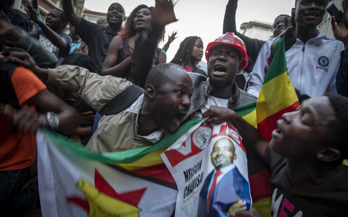 MDC supporters celebrate outside the MDC headquarters after what was earlier allegedly announced by their leadership as a win for the 2018 Zimbabwe elections. Picture: Thomas Holder/EWN