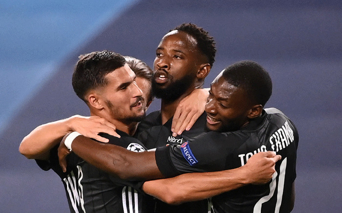 Lyon's French forward Moussa Dembele (2R) celebrates scoring his team's second goal during the UEFA Champions League quarter-final football match between Manchester City and Lyon at the Jose Alvalade stadium in Lisbon on 15 August 2020. Picture: AFP