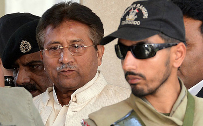 FILE: Former Pakistani President Pervez Musharraf being escorted by authorities. Picture: AFP