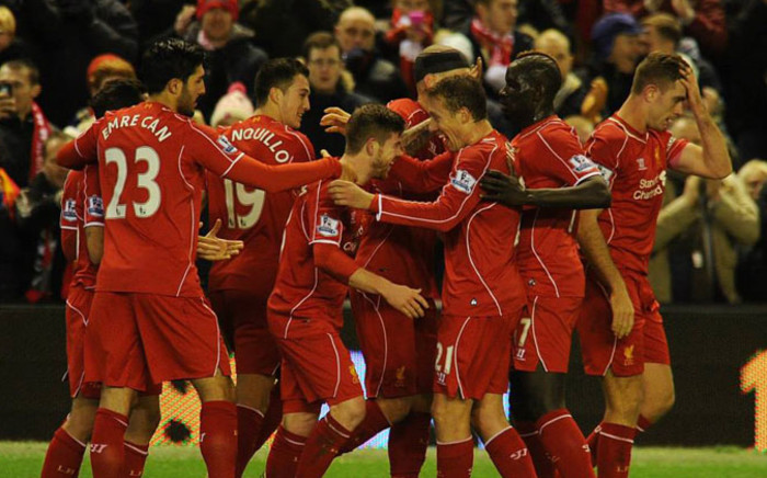 Liverpool players celebrate with Adam Lallana after his goal against Swansea City in the English Premier League on 29 December 2014. Picture: Liverpool Official Facebook page.