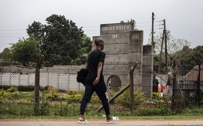 A Swazi man walks past the main entrance of the formerly known University of Swaziland, that will be renamed University of eSwatini. Picture: AFP
