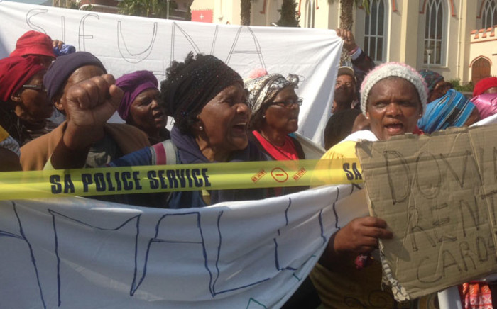 A group of pensioners protest outside Parliament demanding restitution for homes that were demolished during the apartheid era on 3 September, 2014. Picture: Lauren Isaacs/EWN.