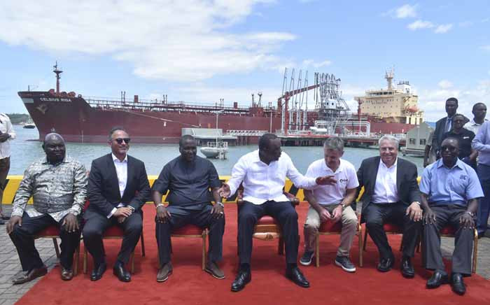 President Uhuru Kenyatta (centre) poses in a group photo with other officials in front of an oil tanker carrying 200,000 barrels of crude oil during the inaugural shipment of crude oil at Kipevu Oil Terminal at Kenya's port city of Mombasa on 26 August 2019. Picture: AFP