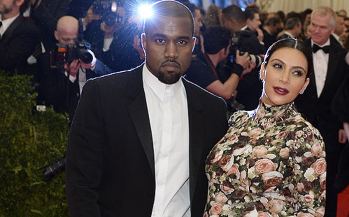 US rapper Kanye West (L) and his girlfriend Kim Kardashian (R). Picture: AFP