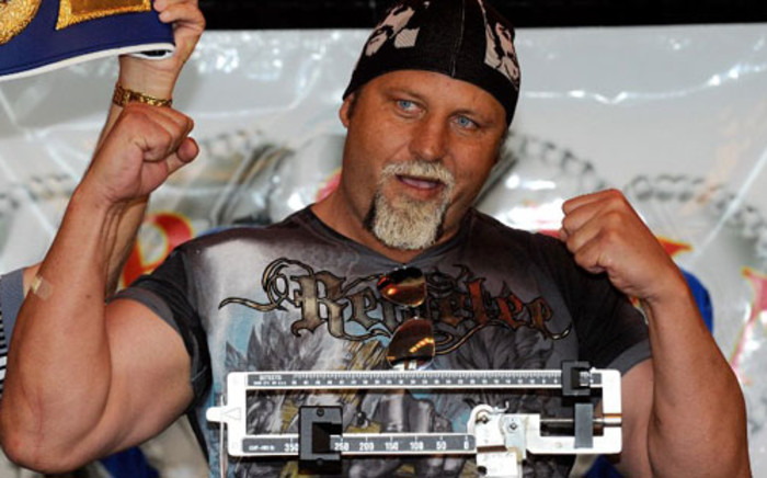 Francois Botha poses on the scale during the official weigh-in for his bout against Evander Holyfield at the Thomas & Mack Center April 9, 2010 in Las Vegas. Picture: AFP