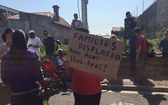 Dozens of people protested outside the old Biscuit Mill Shopping Centre against the eviction of 28 families from Woodstock. Picture: Monique Mortlock/EWN.