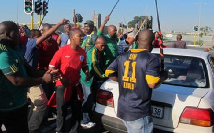 Ceppwawu protesters chant struggle songs outside the Chevron refinery in Milnerton on 12 July 2011. Picture: Malungelo Booi/EWN