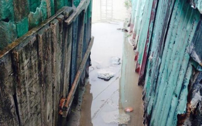Flooding in between shacks in Khayelitsha on 6 July. Picture: Shamiela Fisher/EWN.