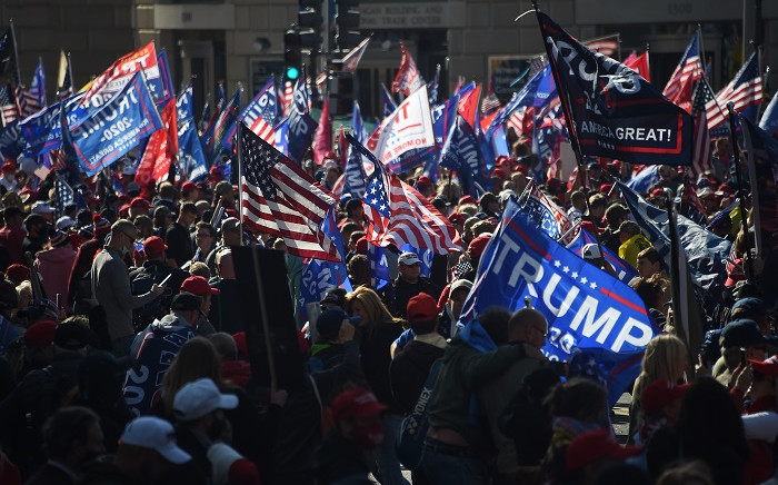 FILE: Supporters of former US President Donald Trump rally in Washington, DC, on 14 November 2020. Supporters are backing Trump's claim that the 3 November election was fraudulent. Picture: AFP.