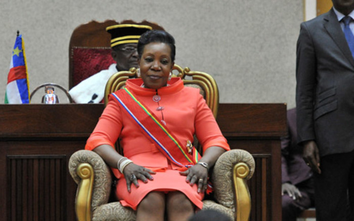 Central African Republic's new interim president Catherine Samba Panza sits in the presence of members of the constitutional court after her swearing-in ceremony in Bangui on 23 January, 2014. Picture: AFP.