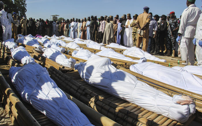 Mourners attend the funeral of farm workers in Zabarmari, about 20km from Maiduguri, Nigeria, on 29 November 2020 after they were killed by Boko Haram fighters in rice fields near the village of Koshobe on 28 November 2020. Picture: AFP.