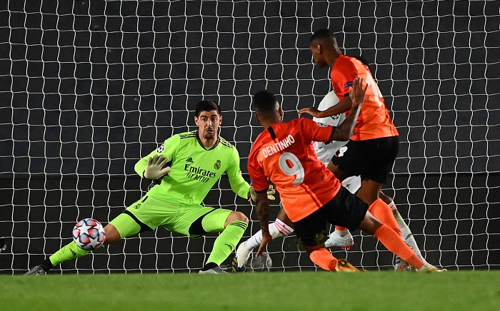 Real Madrid's Belgian goalkeeper Thibaut Courtois (back) blocks a shot on goal during the UEFA Champions League group B football match between Real Madrid and Shakhtar Donetsk at the Alfredo di Stefano stadium in Valdebebas on the outskirts of Madrid on 21 October 2020. Picture: AFP.
