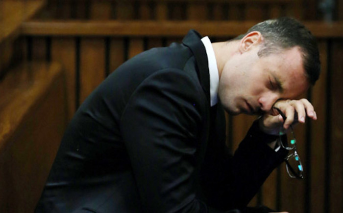Oscar Pistorius wipes his face during his murder trial at the high court in Pretoria on 7 April 2014. Picture: Pool.