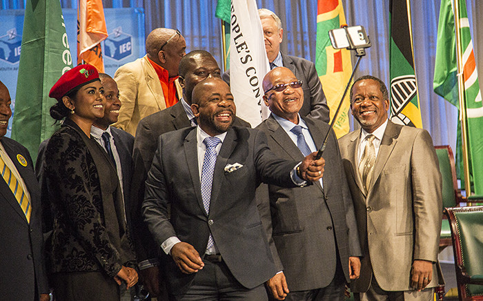 Party representatives of South Africa's thirteen political parties represented in parliament gather to take a selfie after they signed their pledges to abide by the IEC's code of conduct during the 2016 local government elections. Picture: Reinart Toerien/EWN