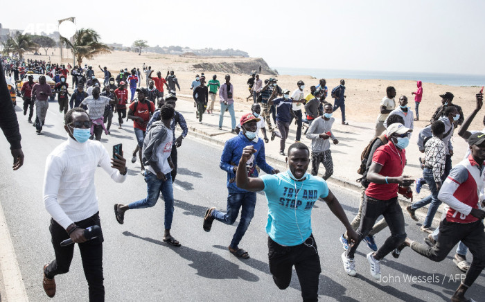 Supporters of Senegal's opposition leader Ousmane Sonko protest in Dakar after he was arrested ahead of his scheduled court appearance to face a rape charge.