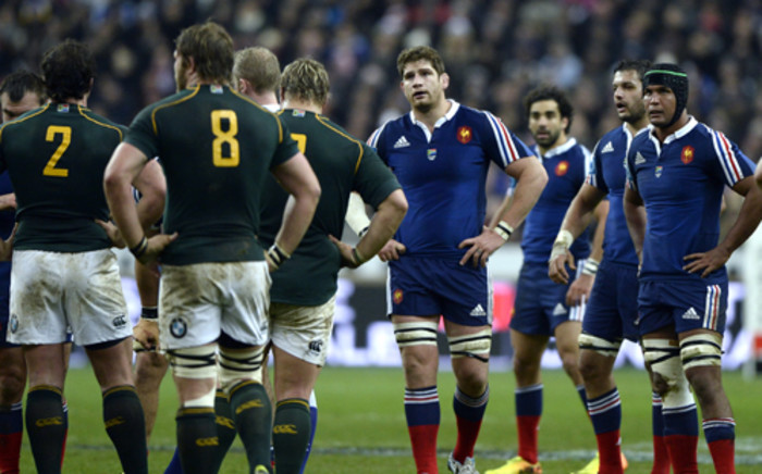 FRANCE, Saint-Denis : (from L) France's lock Pascal Pape, left wing Yohan Huget, N8 Damine Chouly and captain Thierry Dusautoir react during during the international rugby union test match between France and South Africa at the Stade de France in Saint-Denis near Paris on November 23, 2013. South Africa won 19-10. AFP PHOTO / FRANCK FIFE