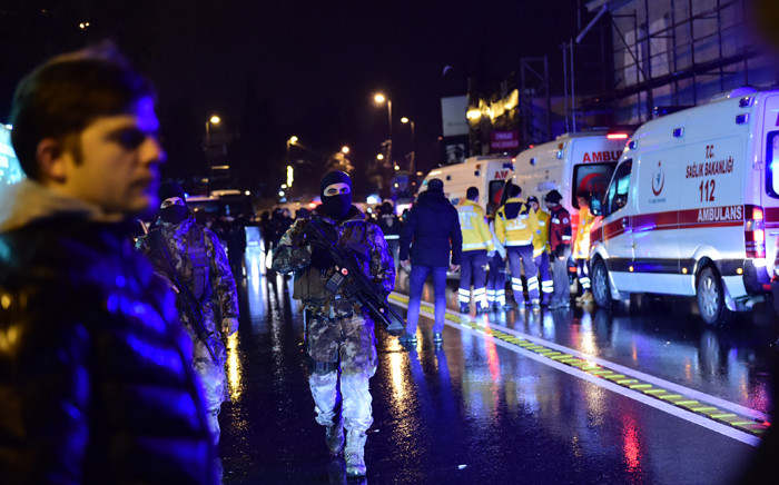 Turkish special force police officers and ambulances are seen at the site of an armed attack 1 January, 2017 in Istanbul. Picture: AFP.