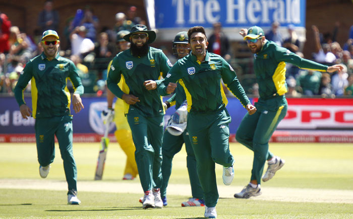 Proteas spinner Tabraiz Shamsi (foreground) celebrates taking a wicket. Picture: AFP