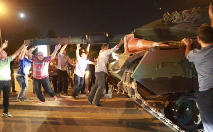 FILE: People take on a tank in Ankara, Turkey during a protest against a military coup on 16 July 2016. Picture: AFP.