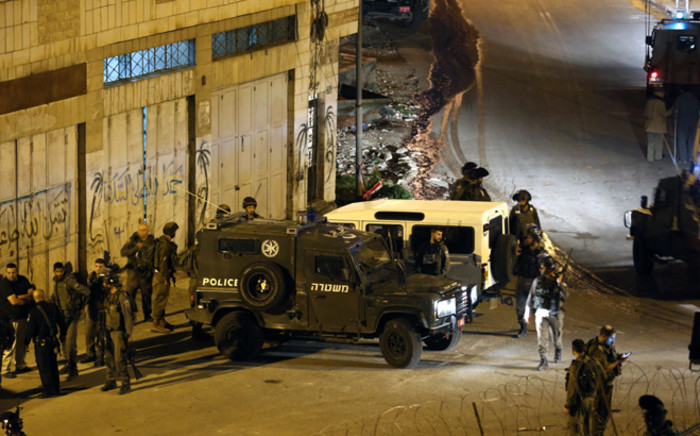 Israeli forces stand guard at the scene of shooting Palestinian female Yasmeen Zaro near the Ibrahimi mosque in the West Bank old city of Hebron 14 Februday 2016. Picture: EPA/ABED AL HASHLAMOUN.