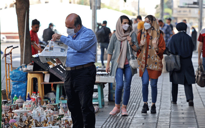 Iranians wear face masks as a measure against the COVID-19 coronavirus, in a street in the capital Tehran, on July 7, 2021. Picture: Atta Kenare / AFP