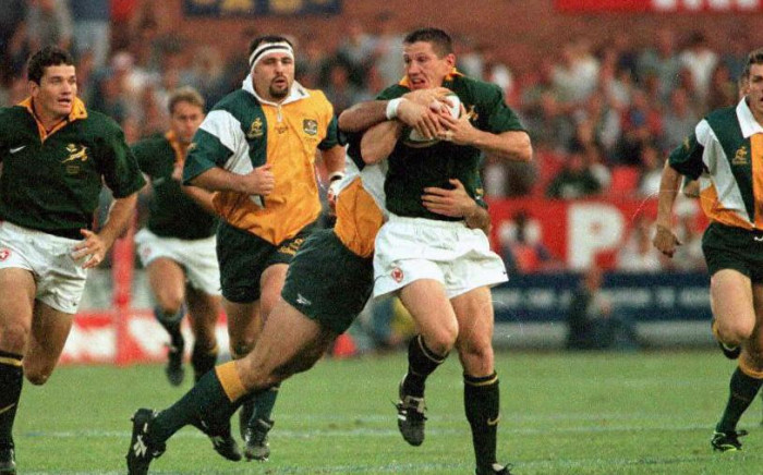 South Africa's Springboks James Small evades a tackle while he clutches the ball during the Tri-Nations test in Pretoria 23 August. Australia suffered a 61-22 defeat. Picture: AFP