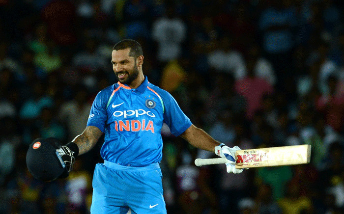 Indian cricketer Shikhar Dhawan celebrates after he scored a century (100 runs) during the first One Day International (ODI) cricket match between Sri Lanka and India at the Rangiri Dambulla International Cricket Stadium in Dambulla on 20 August 2017. Picture: AFP.