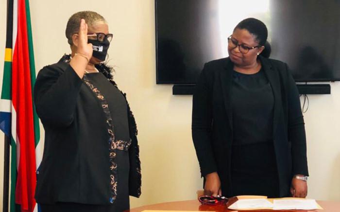 Zandile Gumede (left) is sworn in as a member of the KwaZulu-Natal legislature on 19 August 2020. KZN Legislature Speaker Nontembeko Boyce looks on. Picture: Supplied