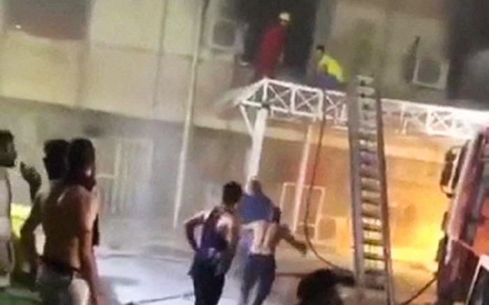 A grab taken from a UGC video obtained from Basim Almohand / ESN, shows Iraqi firefighters battling flames after a fire erupted at the Ibn al-Khatib hospital reserved for the most severe COVID-19 cases, in the capital Baghdad, on April 25, 2021. Picture: Basim Almohand / AFP.