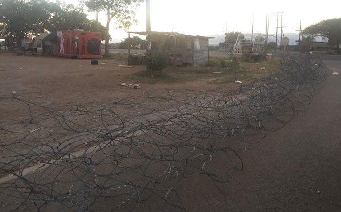 Shops surrounded with barbwire to prevent residents from looting businesses in Vuwani. Picture: EWN.