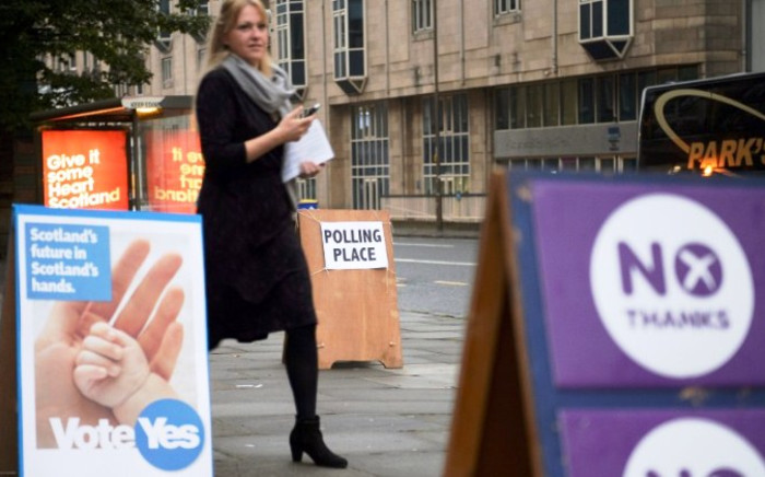 A woman leaves a polling station after casting her vote in Edinburgh, Scotland, on 18 September 2014, during a referendum on Scotland's independence.Picture: AFP.